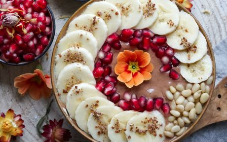 Vegan gluten-free Silken Tofu Chocolate Smoothie Bowl topped with fruit and a flower