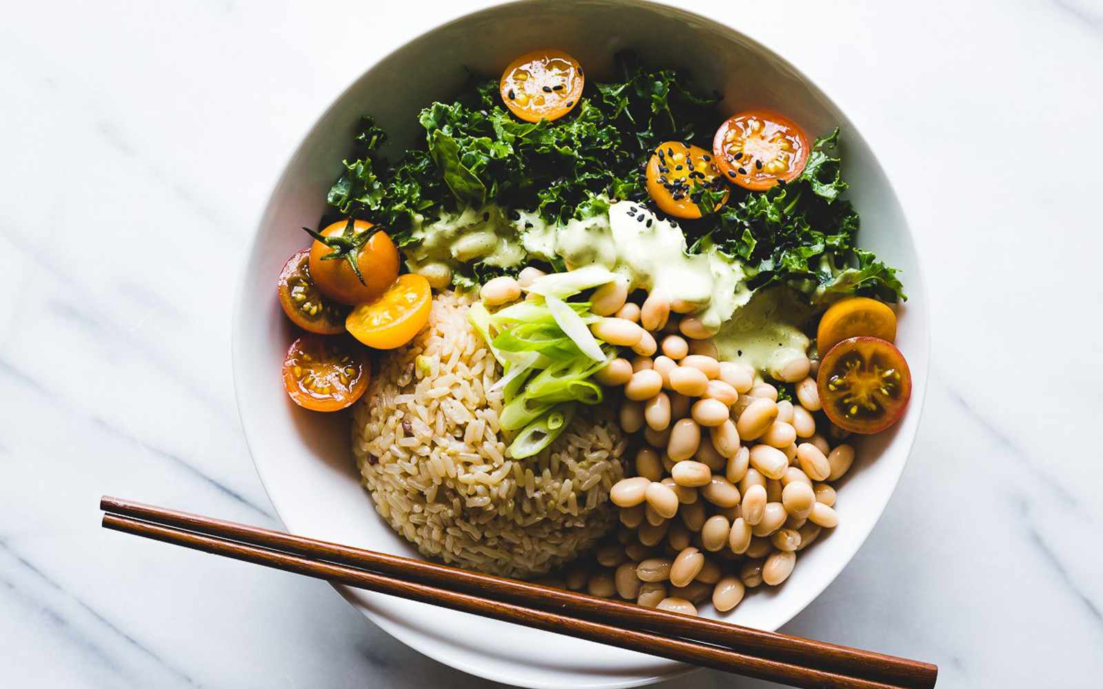 Vegan Gluten-Free Green Thai Curry Rice Bowl with white beans, tomatoes, and kale