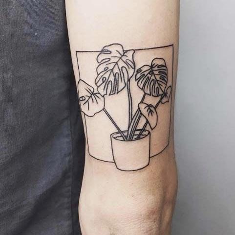 black white monstera tattoo