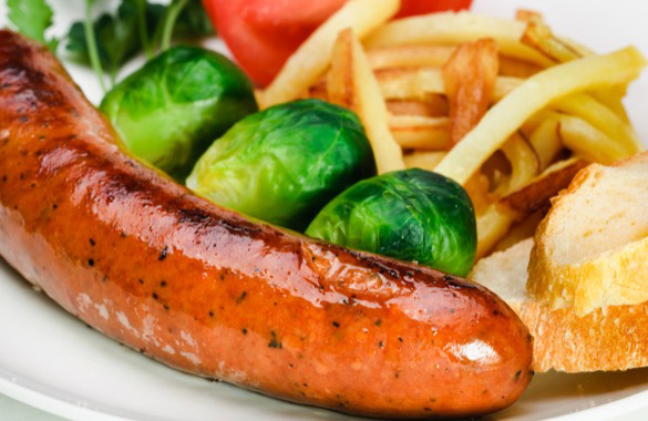 German sausage with potatoes and vegetables.