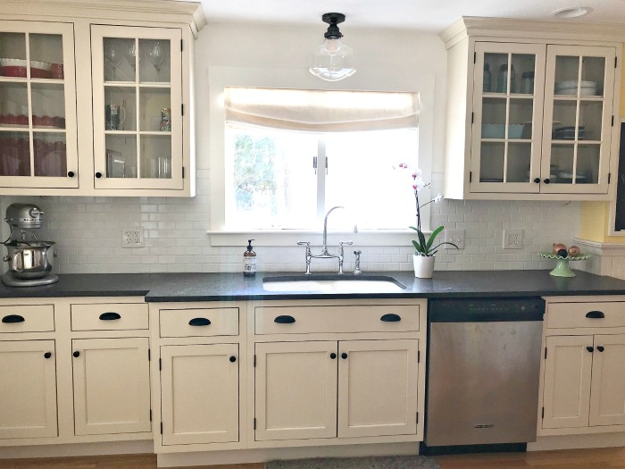 cream cabinets white subway tile backsplash black ... on Kitchen Backsplash With Black Countertop  id=88940