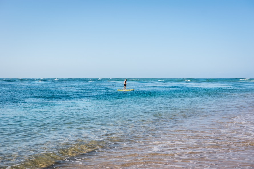 Man paddleboarding in the ocean in Mozambique