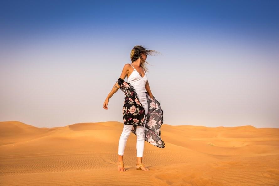 travel blogger girl in desert in dubai