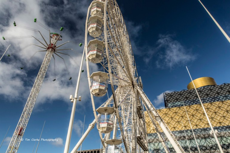 The Big Wheel and Skyrider in Centenary Square, Birmingham, with the Library behind.