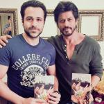 Emraan Hashmi gives a copy of his book to Shah Rukh Khan