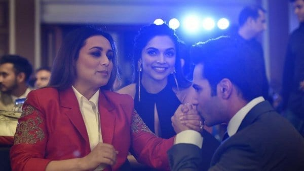 Varun Dhawan kissing Ranu Mukherji's hand while Deepika Padukone looks on