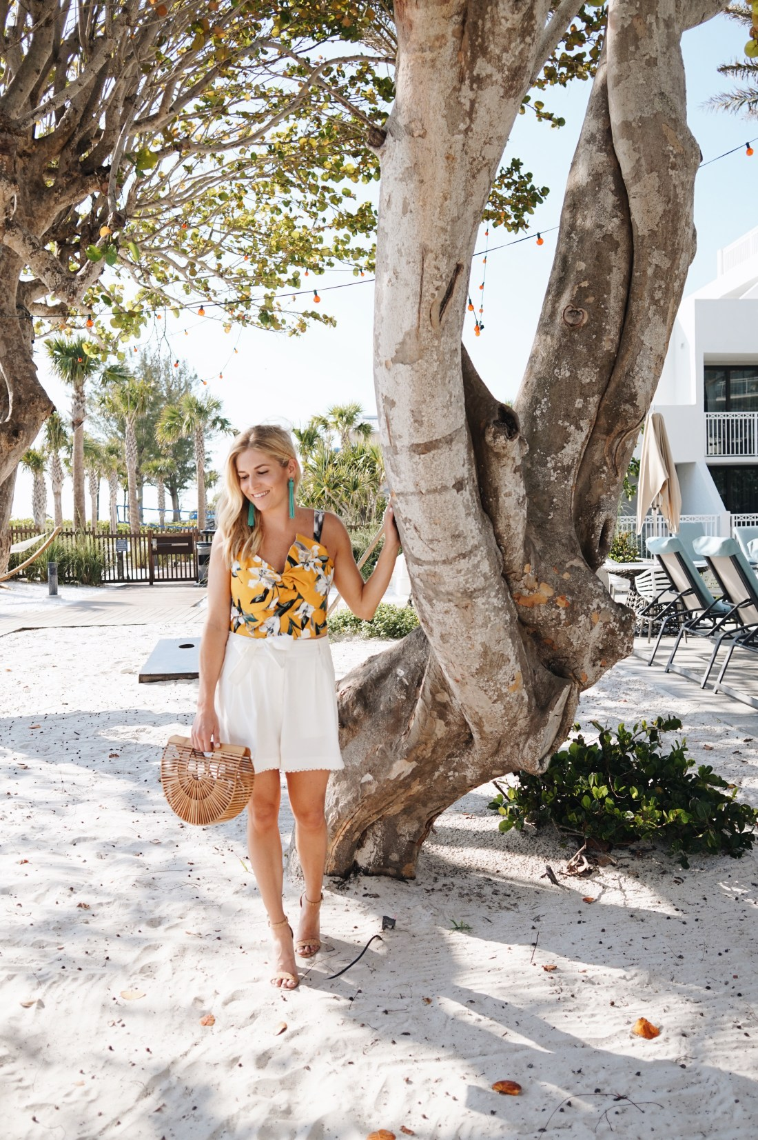 Yellow floral blouse paired with high waisted white shorts