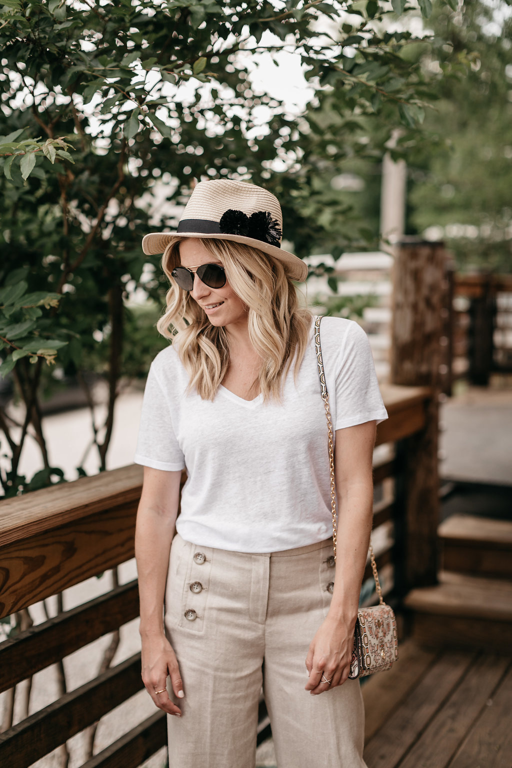 One Small Blonde | Brooke Burnett is wearing a basic white t-shirt and a wide leg sailor pants