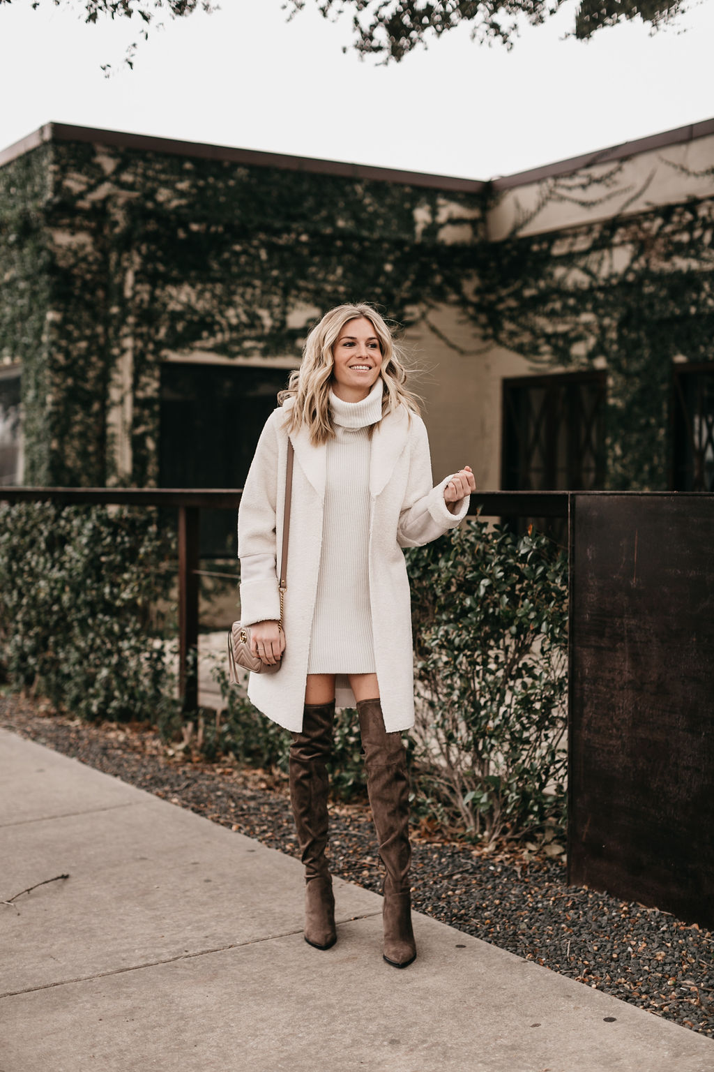 dallas fashion blogger, is wearing a white sweater dress and marc fisher over the knee boots