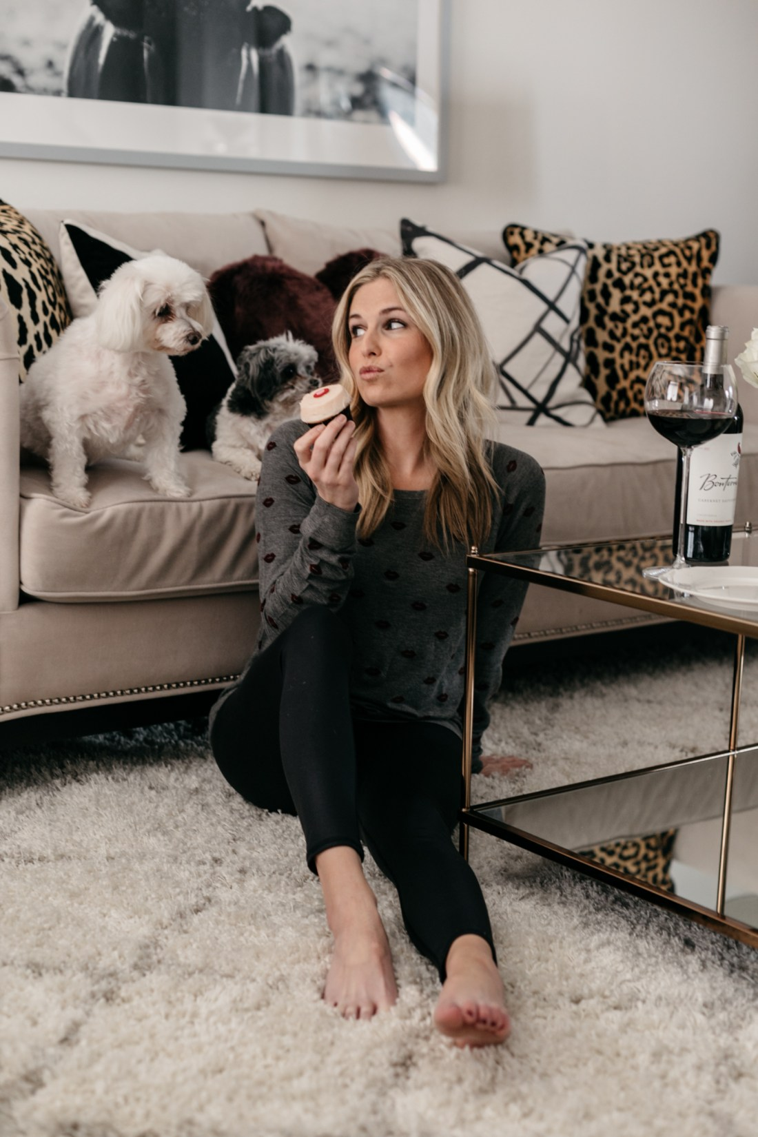 Brooke Burnett with her dogs eating cupcake and drinking wine
