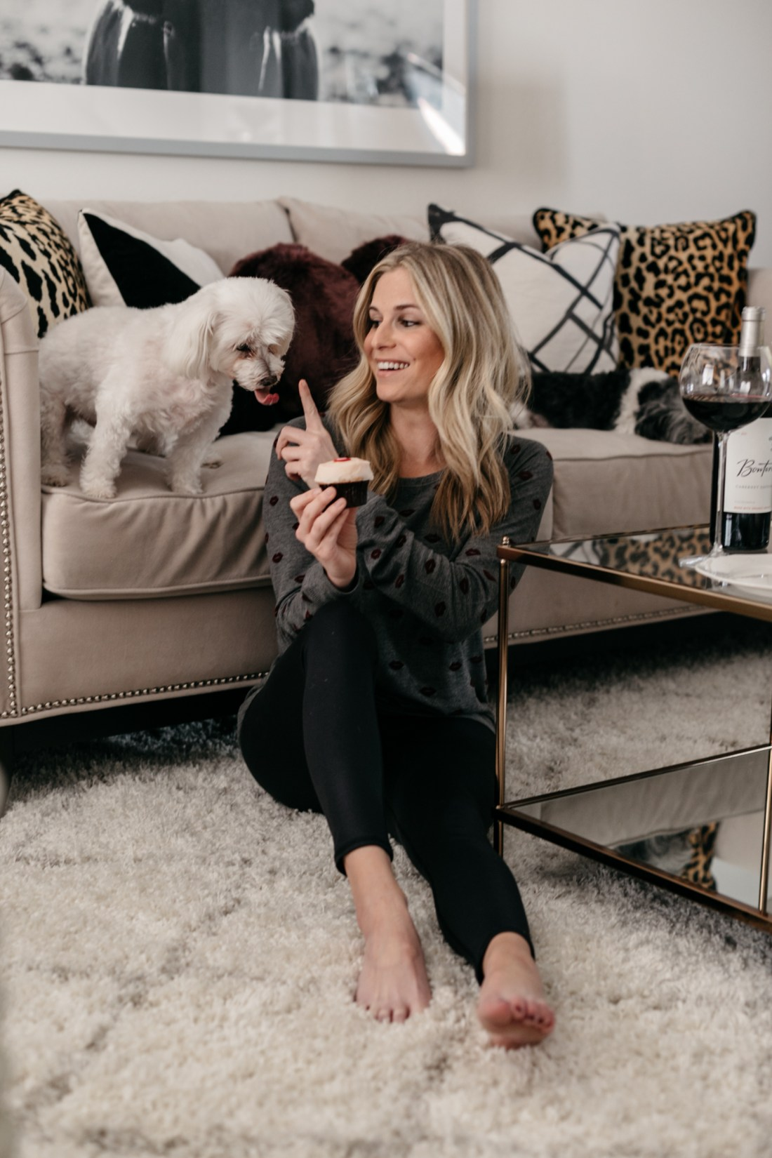 Brooke Burnett with her dog eating cupcake and drinking wine