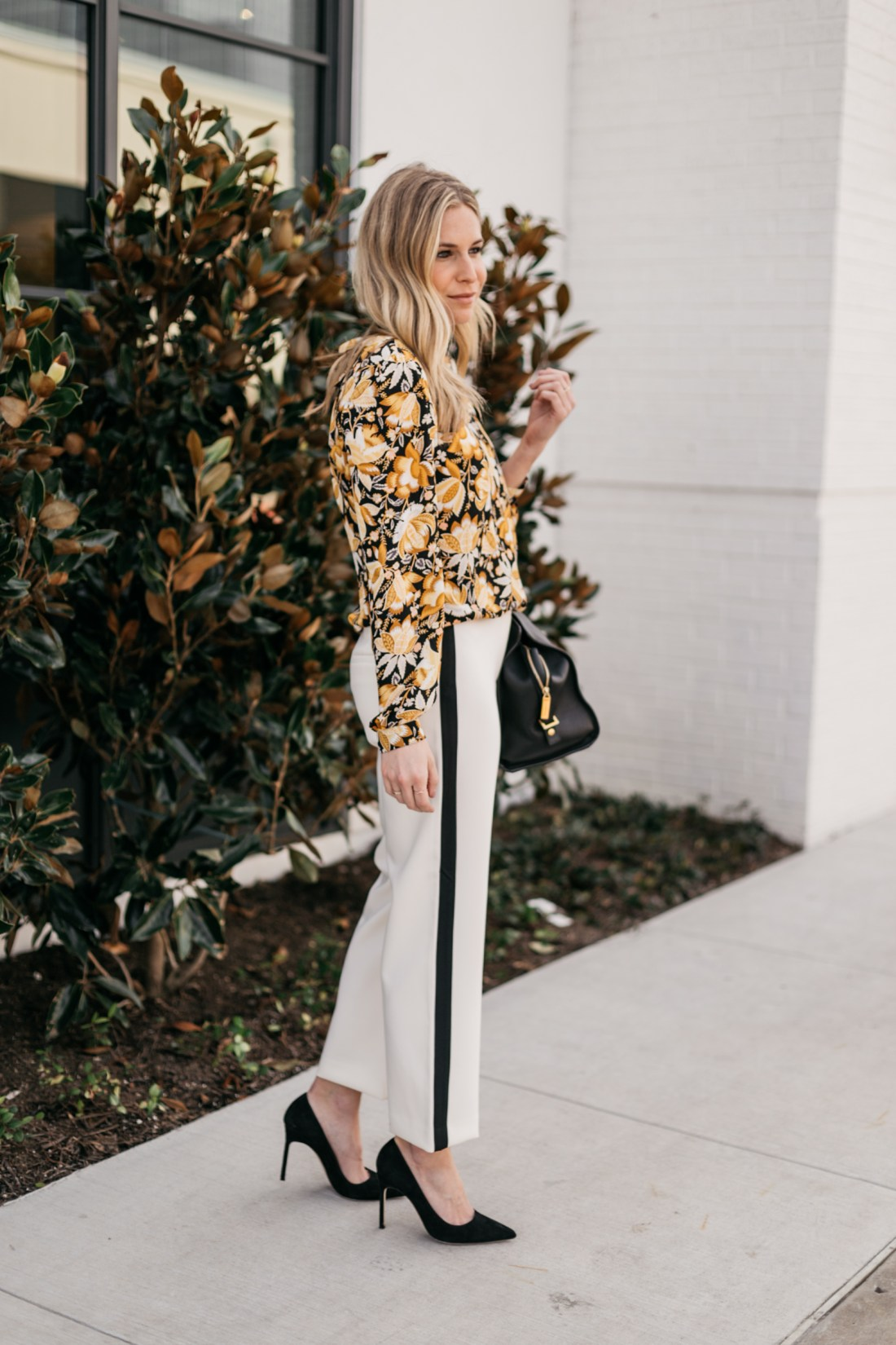 OUTFIT 2  White with Black Stripe Pants // Yellow and Black Floral Long Sleeve Blouse // Black Suede Heels // Black Work Bag