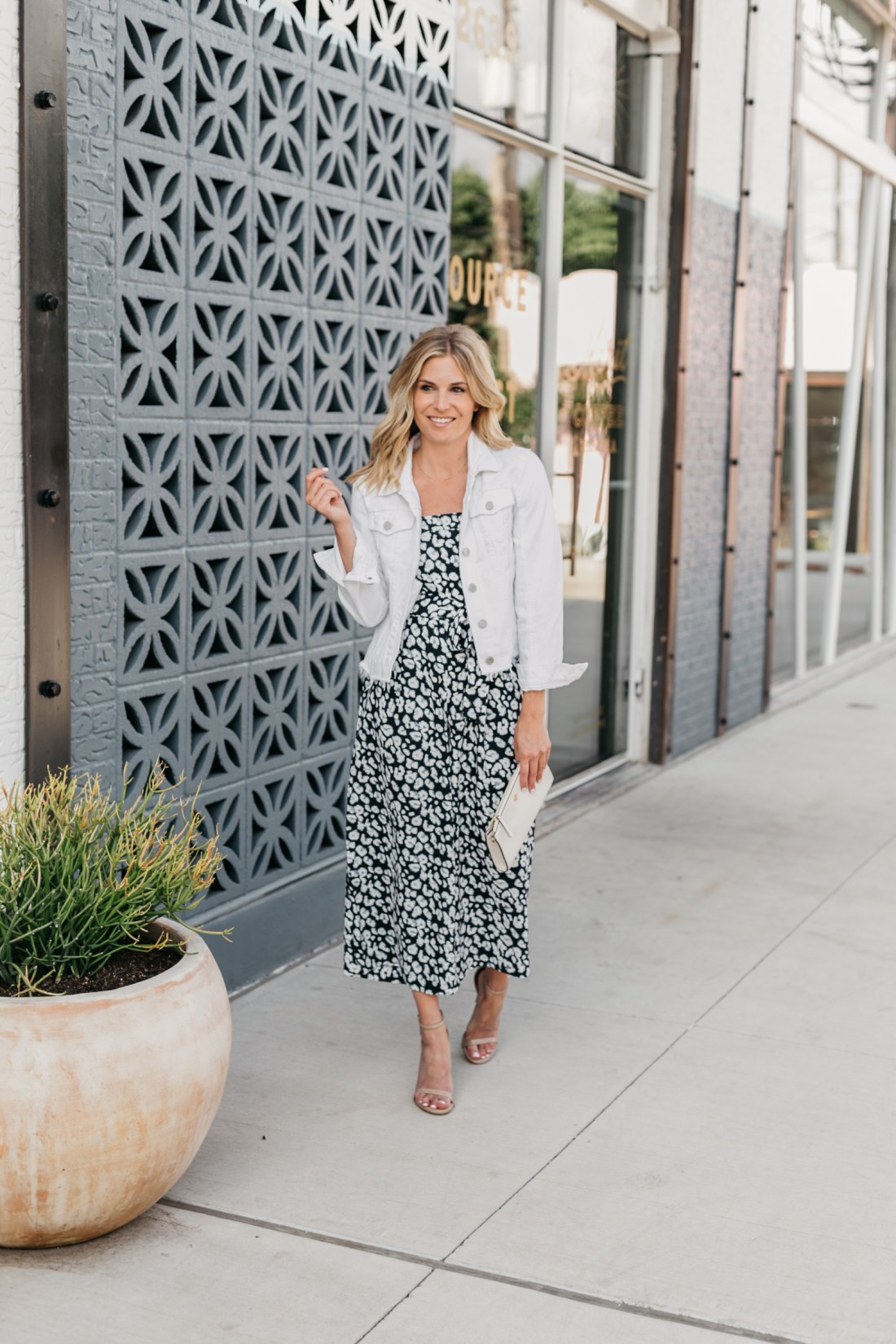 One Small Blonde is wearing a navy leopard jumpsuit from Banana Republic