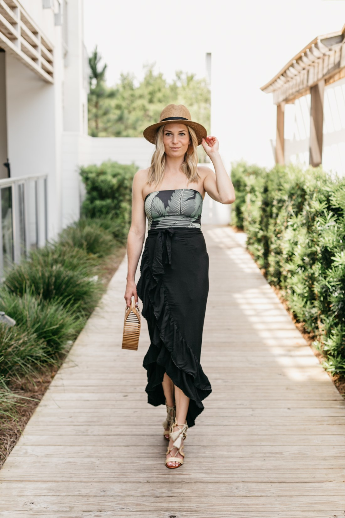 Broke Outfit Details: Palm Print Bodysuit/Swimsuit // Black Ruffle Midi Skirt // Strappy Heel // Straw Hat // Wooden Bag