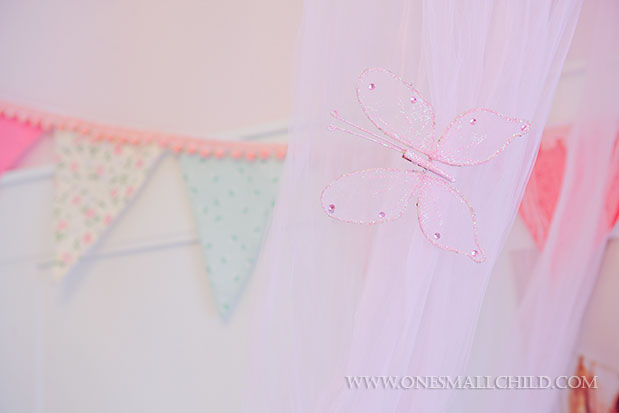 Great idea for dressing up a pink crib canopy | See the entire nursery at One Small Child: www.onesmallchild.com