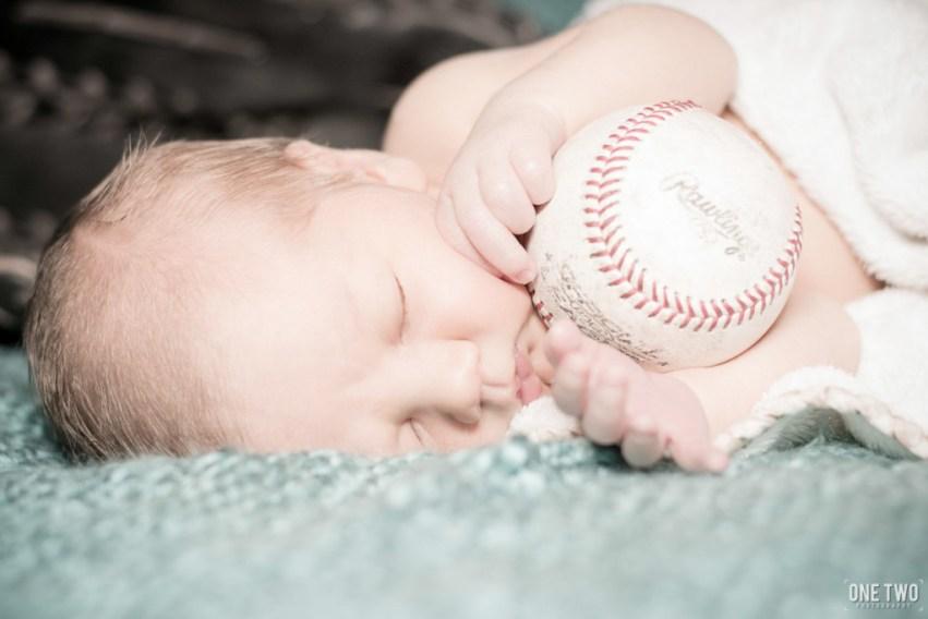 baby holding baseball