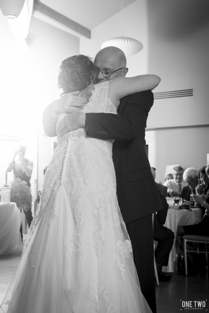 father dancing with daughter at wedding