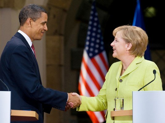 US President Barack Obama and German Chancellor Angela Merkel shake hands during a joint press conference on June 5, 2009 at Dresden Castle in the center of the eastern German town of Dresden. After policy talks and a news conference in Dresden, Obama and Merkel are due to travel to Buchenwald, the former Nazi concentration camp where more than 56,000 prisoners died in horrendous conditions. Obama today swaps the political heat of the Middle East for a solemn two-day mission of World War II remembrance, and a fresh round of transatlantic diplomacy.   AFP PHOTO / Saul LOEB
