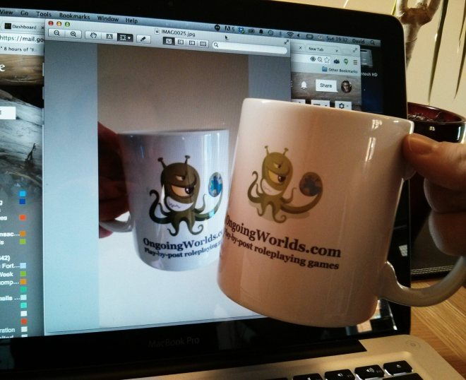 David Ball holding up mug for virtual cheers with Andy Longman from Blue Dwarf