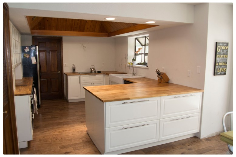 Changed to single level peninsula with 4 drawer storage where bar during old kitchen renovation.