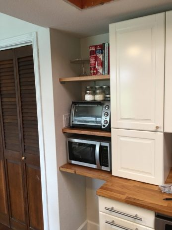 Built-in storage for microwave, toaster oven, cookbooks and trash nook.