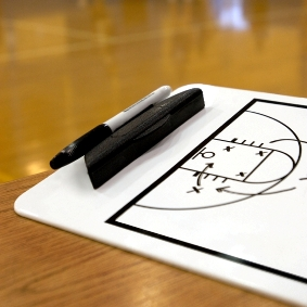 Basketball coach's clipboar with play drawn up