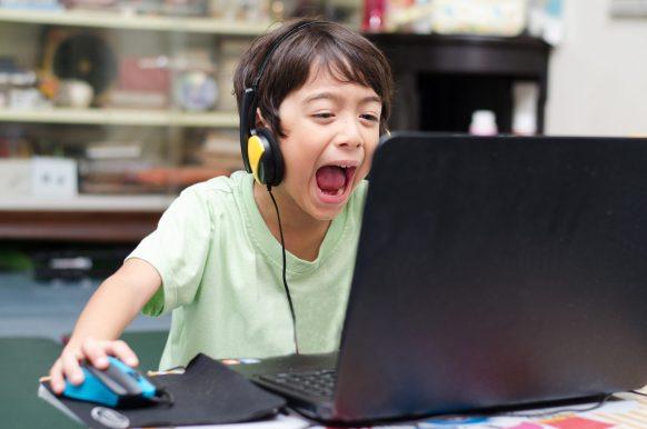 Boy Gaming at Computer