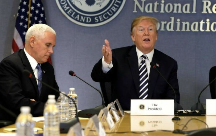 Weird moment where Vice President Mike Pence is imitating Donald Trump with water bottle