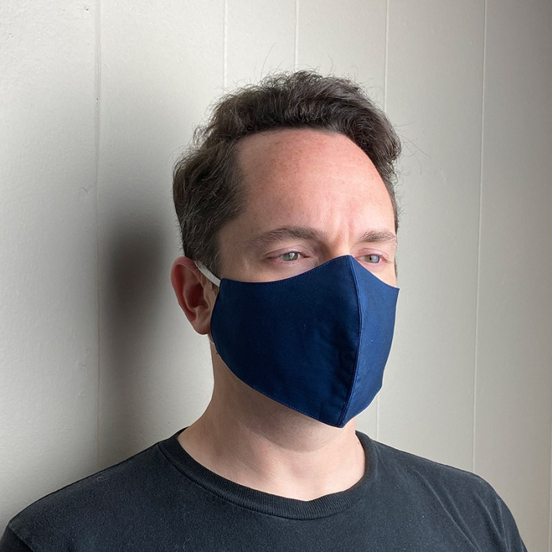 navy face mask worn by man
