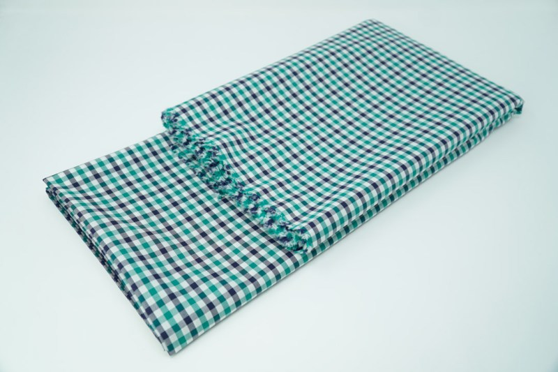 white with green and navy check cotton face mask material