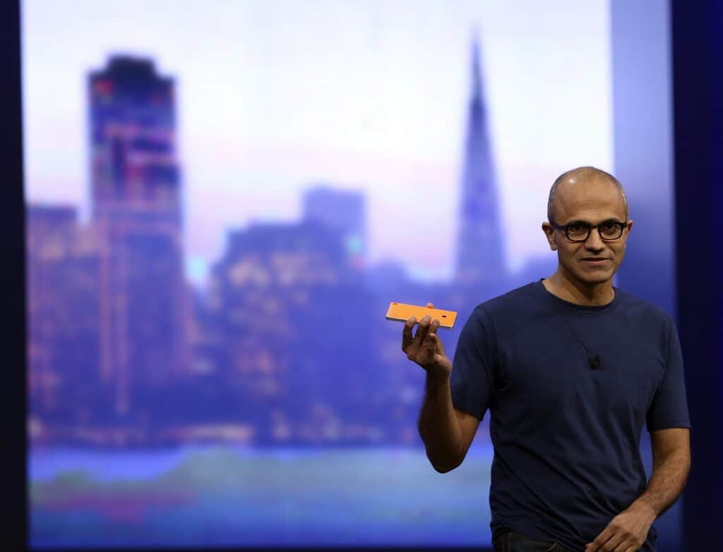 "Microsoft CEO Satya Nadella holds a Nokia Lumia mobile phone featuring Windows 8.1 operating system during his keynote address at the company's ""build"" conference in San Francisco, California April 2, 2014. REUTERS/Robert Galbraith (UNITED STATES - Tags: BUSINESS SCIENCE TECHNOLOGY) - RTR3JOP3"