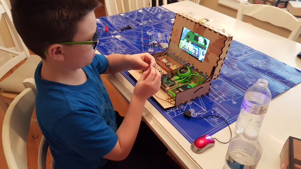 A kid building the Piper Computer Kit.