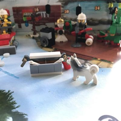 #legocityadvent Day 22: today the city folk are joined by a husky complete with feeding trough..