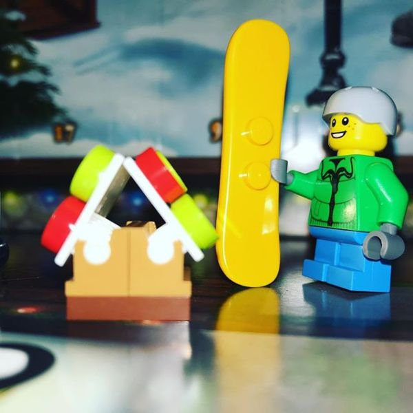 Snowboard boy admiring his gingerbread house #legocityadvent