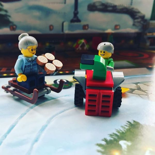 Snowboard boy & pizza Granny discussing today's addition to #legocityadvent
