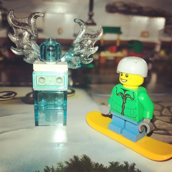 Snowboard boy admiring the angel who has appeared in #legocityadvent