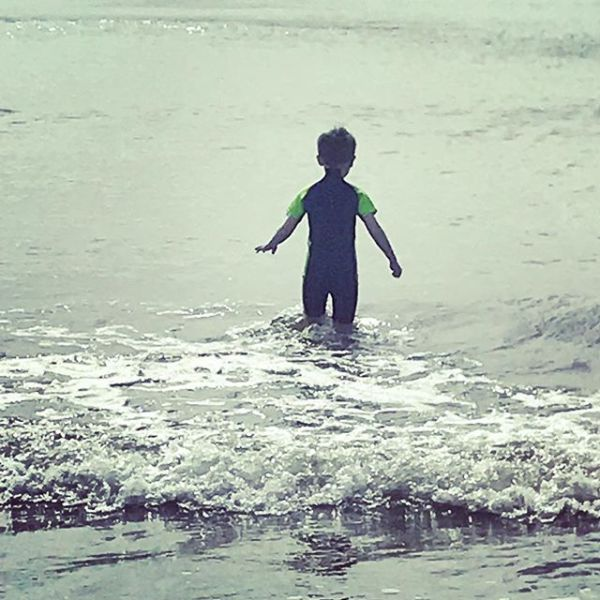 A really happy Sqk - we promised him beach & yes it isn't the warmest but he is enjoying himself in his new wetsuit.