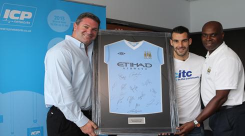 Alvardo Negredo and Alex Williams present ICP Networks MD Matt Archer with a signed Manchester City shirt