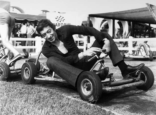 FRANCE - JULY 22: Singer Serge Gainsbourg sits in a kart on July 22, 1969 in France. (Photo by Keystone-FranceGamma-Rapho via Getty Images)