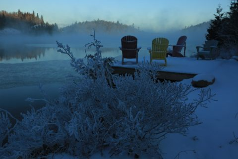 Colourful muskoka chairs on the Red Rock Lake dock, on a frosty and misty early winter morning; photo by Bob Elliott, Ontario Parks