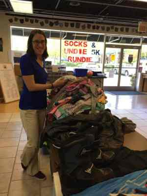 Nancy Haworth sorting clothing at Note in the Pocket