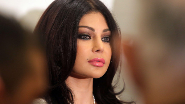 Lebanese Pop Star Haifa Wehbe arrives for a press conference before being appointed communications Ambassador for humanitarian issues for Lebanon on October 18, 2013 at a hotel in Beirut. The new position of Haifa aims in raising awareness of the technology used to while driving which could cause on the roads.  AFP PHOTO/JOSEPH EID