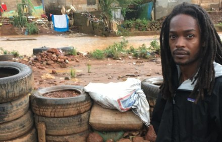 Seyi in front of flood defences, Congo Cross.
