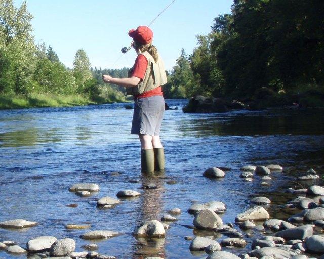 girl fly fishing