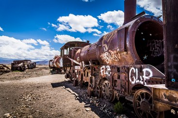 The 'Great Train Graveyard' sits along the side of Salar de Uyuni, a collection of trains left to rust and decay in the natural elements creating a ghostly and intriguing cemetery of locomotives. Photo credit: Tobias Mayr