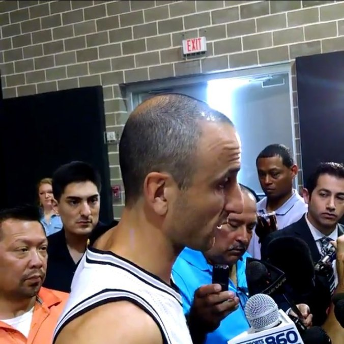 Stephen Anderson, second from left, interviewing Manu Ginobili