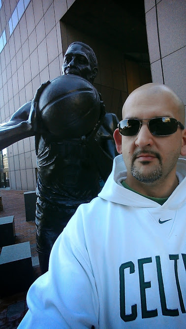 John Karalis (right) alongside the statue of Bill Russell in Boston's City Hall Plaza