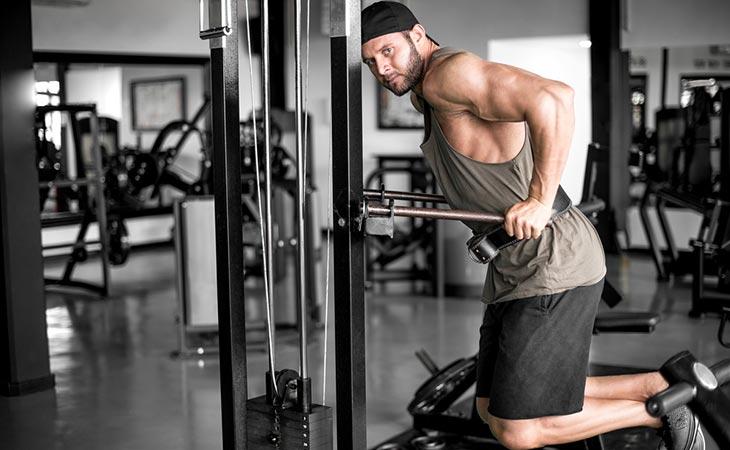 Man Doing Various Dip Machine Exercise Workout