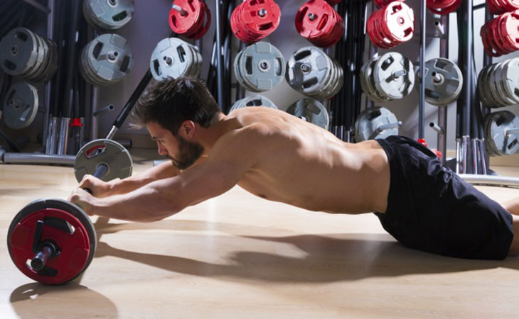Man Doing The Barbell Rollouts Exercise For Abs