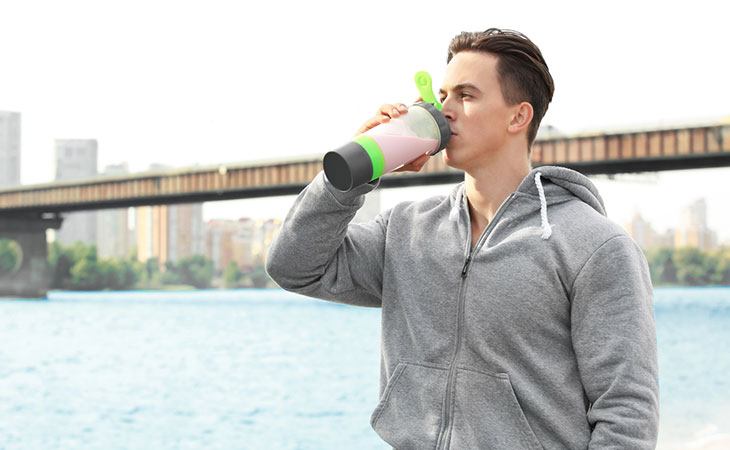 Man Drinking BCAA Protein Supplements Before Exercise